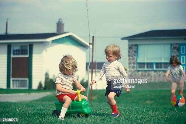 Children playing in their front yard