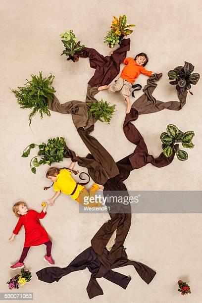 Children playing monkeys in tree