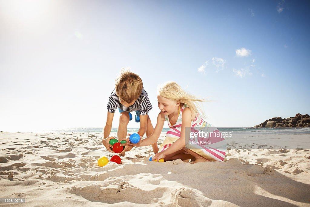Children (6-8) playing on beach : Stock Photo