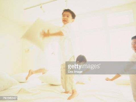 Children playing on bed : Stock Photo