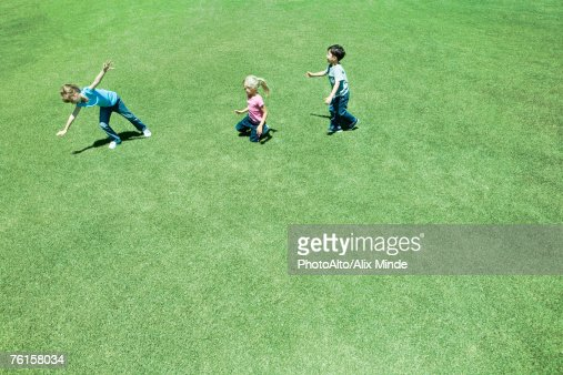 'Children playing on grass, high angle view'
