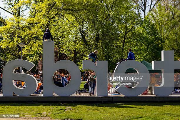 Children playing on IAmsterdam sign in Vondelpark