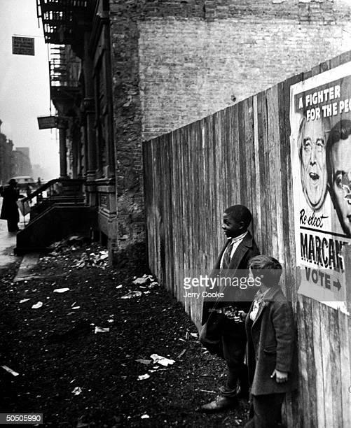 Children playing on littered sidewalk in Harlem