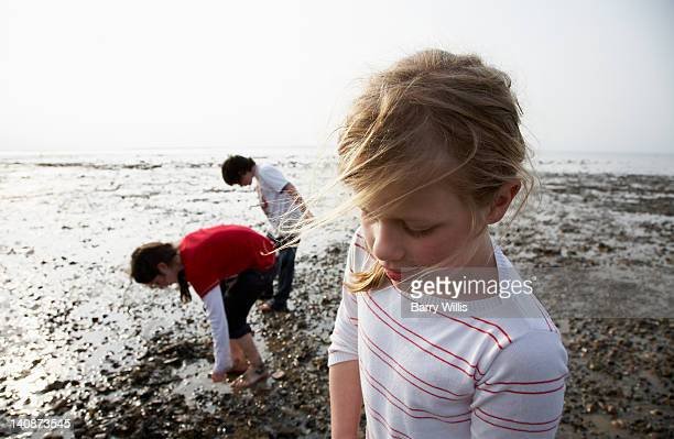 Children playing on rocky beach