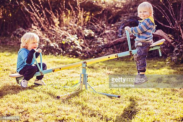 Children playing on seesaw
