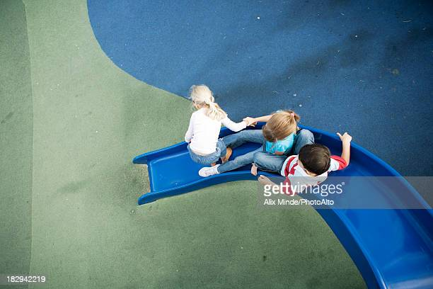 Children playing on slide, overhead view