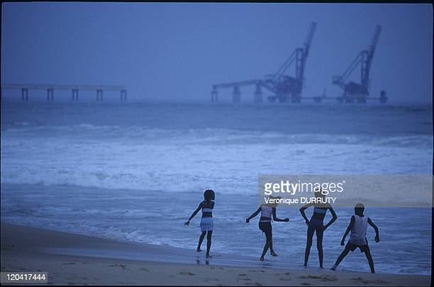 Children Playing On The Beach Facing Oil Equipment In Pointe Noire Congo