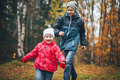 Children Brother and Sister Play in the Meadow in the Autumn Forest
