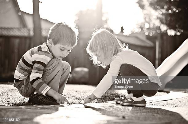 2 Children playing outside black and white