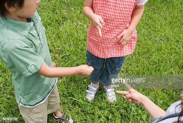 Children playing rock, paper, scissors