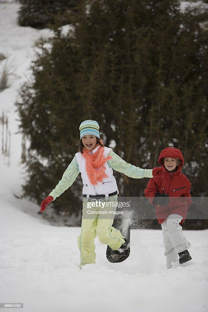 Children playing snow : Stock Photo