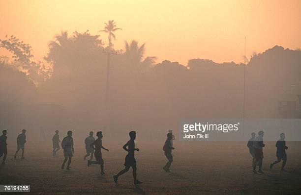 Children playing soccer at sunset, Tha Khaek, Khammuan, Laos, South-East Asia