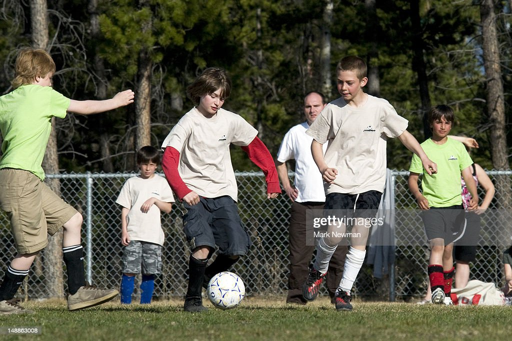 Children playing soccer. : Stock Photo
