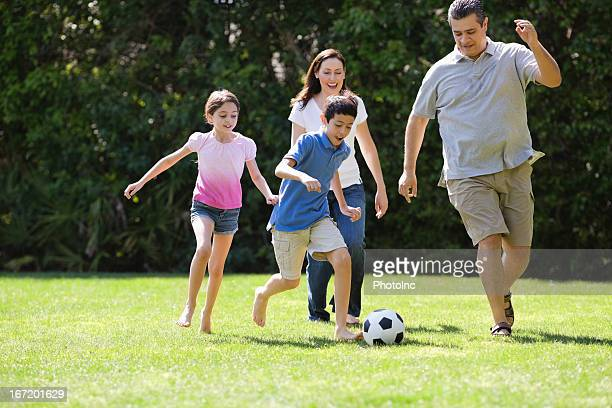 Children Playing Soccer With Parents