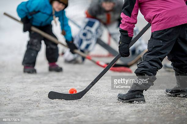 Children Playing Street Hockey