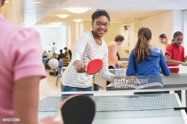 Children playing table tennis in community center