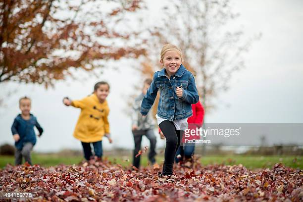 Children Playing Tag in the Leaves