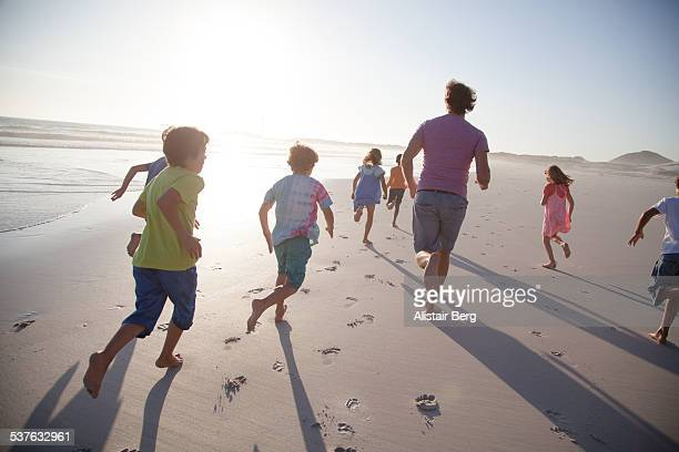 Children playing together on a beach
