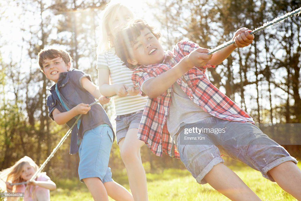 Children playing tug o war : Stock Photo