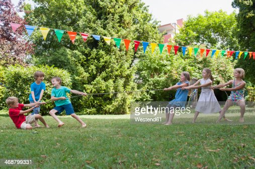 Children playing tug-of-war on a birthday party