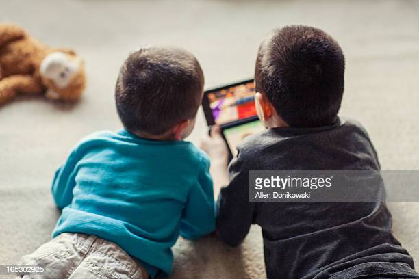children playing video game on floor together