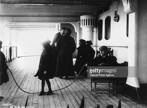 Children playing with a skipping rope on the 2nd saloon deck of the Cunard liner RMS Lusitania