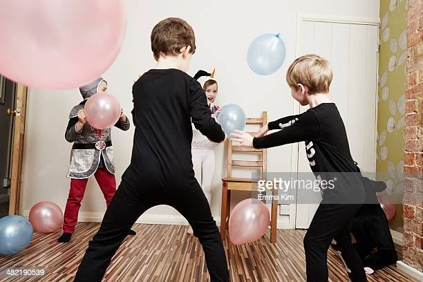 Children playing with balloons at birthday party