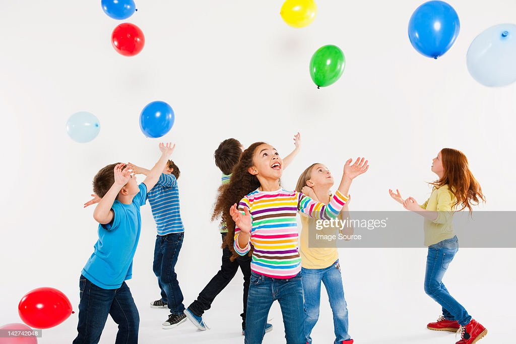 Children playing with balloons : Stock Photo