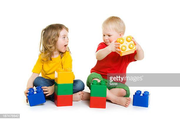 Children playing with bricks