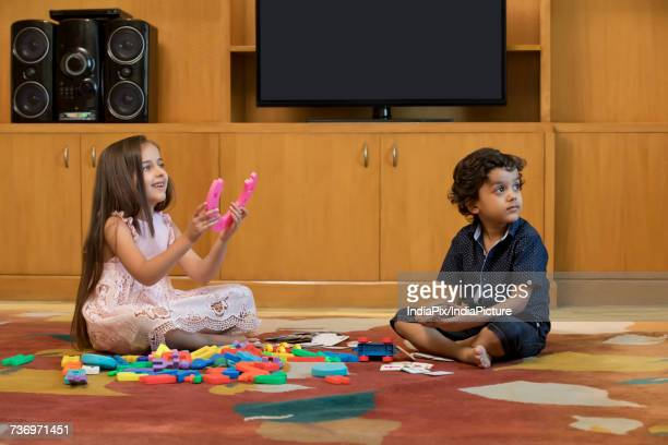 Children playing with building block in living room