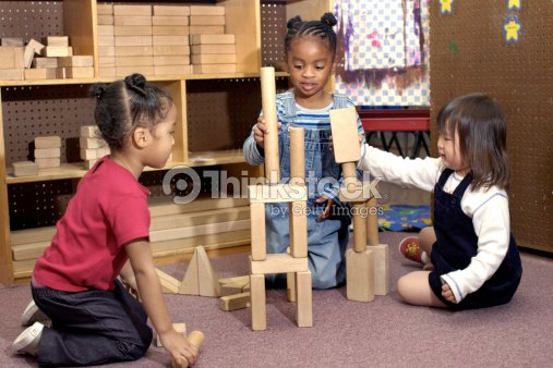 Children Playing With Building Blocks Stock Photo | Thinkstock