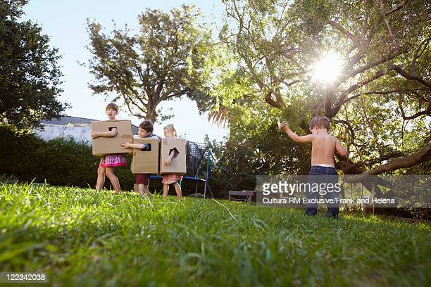 Children playing with cardboard boxes
