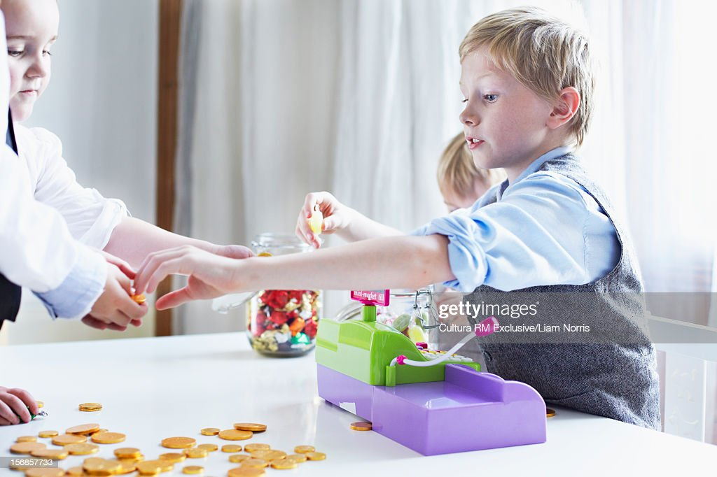 Children playing with cash register : Stock Photo