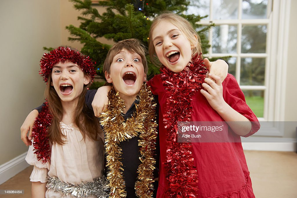 Children playing with Christmas tinsel