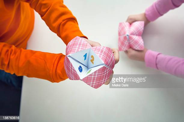 children playing with decision paper game