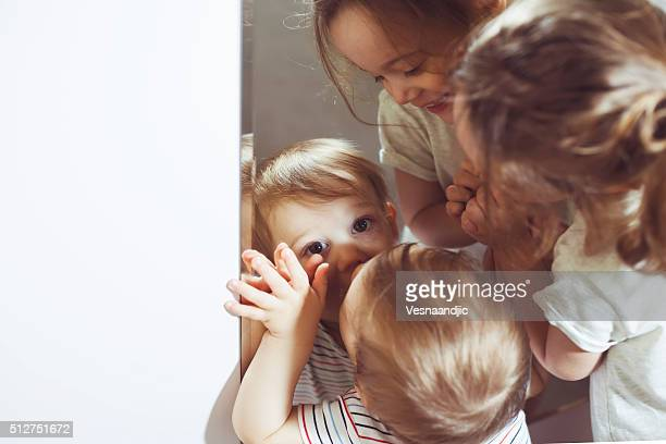 Children playing with mirror