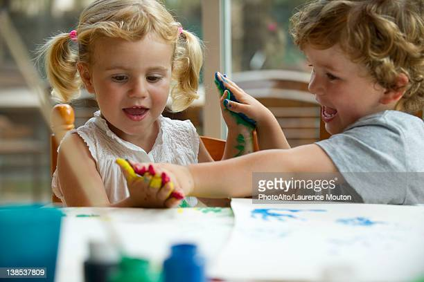 Children playing with paint together