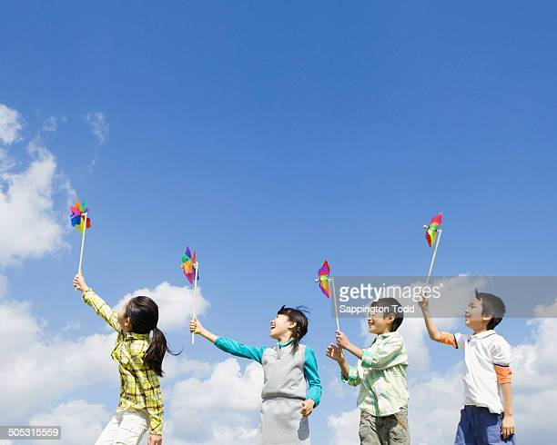 Children Playing With Pinwheel