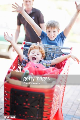 Children playing with shopping cart : Stock Photo