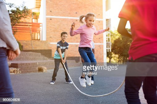 Children playing with skipping rope : Stock Photo