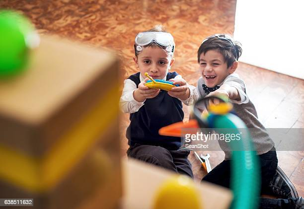 Children Playing with Their Toy Robot