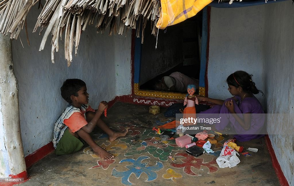 Children playing with toys in front of their hut after the cyclone Phailin on October 15, 2013 in Chattapur, India. Cyclone Phailin on Sunday left a trail of destruction knocking down lakhs of homes affecting nearly 90 lakh people and destroying paddy crops worth about Rs 2,400 crore, but Odisha and Andhra Pradesh escaped from widespread loss of life due to timely and efficient evacuation efforts .