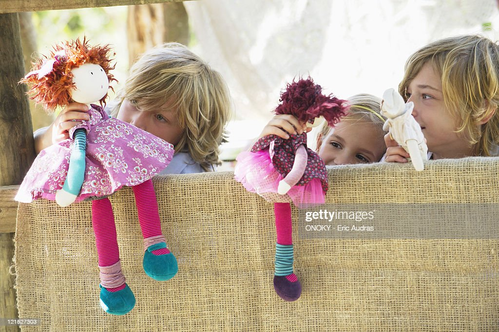 Children playing with toys in tree house