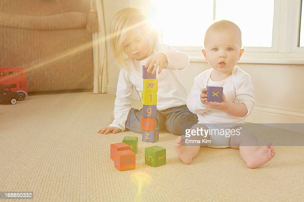 Children playing with toys on floor