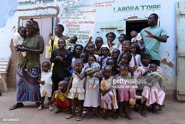 Children pose at the 'ONO' orphanage in the MaliMaka district in the 5th arrondissement of Bangui on January 6 2014 Pierrette the director of the...