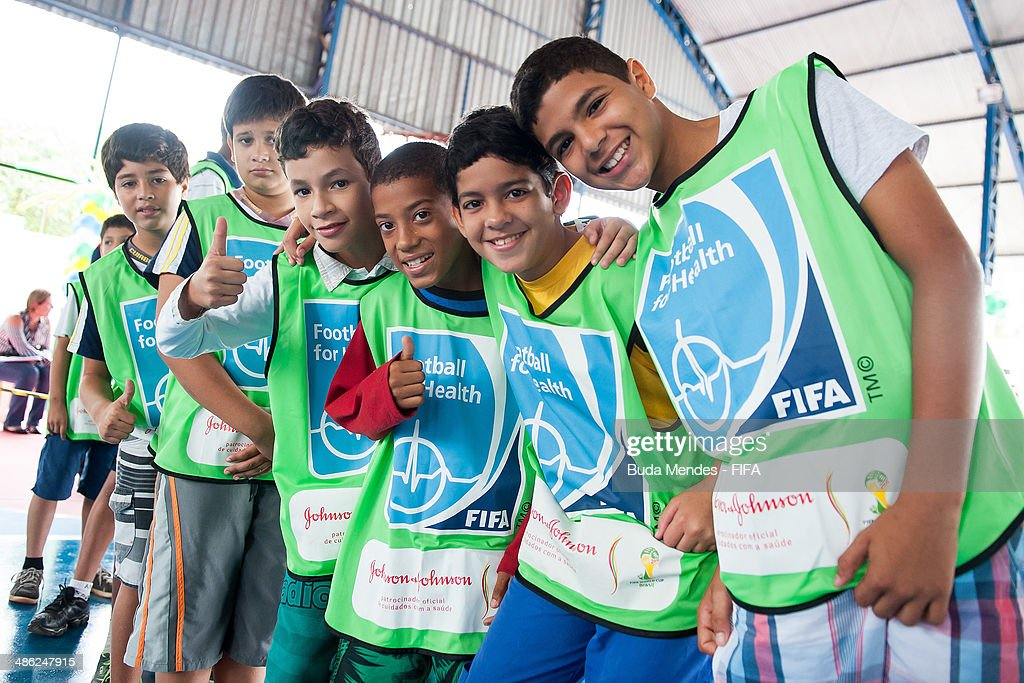 Children pose for photo during visit the FIFA 11 for Health Program as part of the 2014 FIFA World Cup Host City Tour on April 23, 2014 in Cuiaba, Brazil