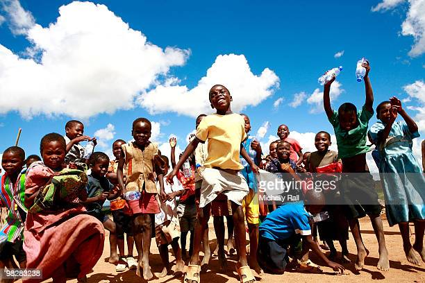 Children pose for the cameras on April 6 2010 in Lilongwe Malawi Madonna visited the Raising Malawi Academy for Girls where a brief ceremony was held...