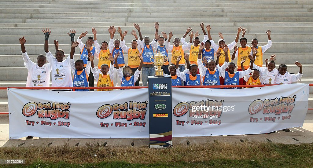 Children pose with the Webb Ellis Cup prior to the IRB Get Into Rugby tournament during a visit to Andohatapenaka Stadium during the Rugby World Cup Trophy Tour in Madagascar in partnership with Land Rover and DHL ahead of Rugby World Cup 2015 on July 5, 2014 in Antananarivo, Madagascar.
