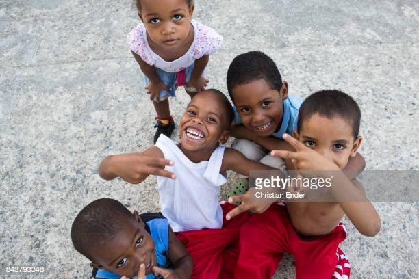 Santo Domingo Dominican Republic November 30 2012 Children posing and joking in front of the camera in the neighbourhood 'The Guandules' National...