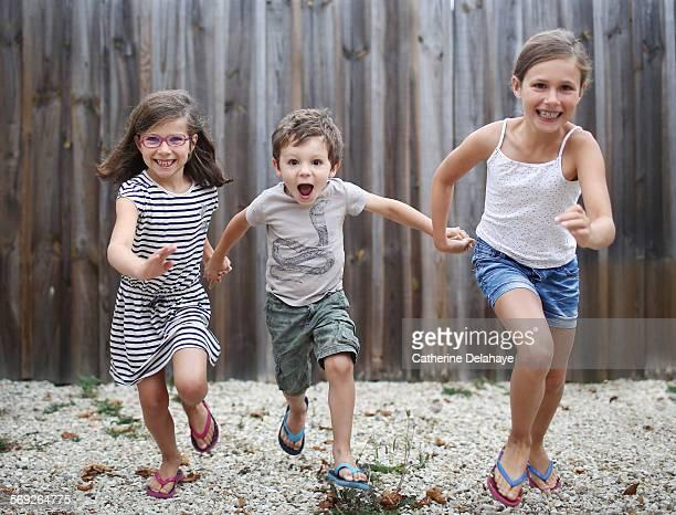3 children posing together